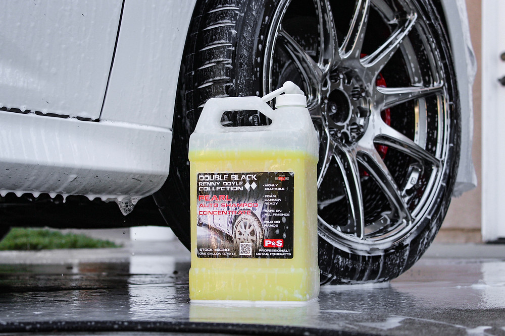 Pearl Auto Shampoo Concentration in Front of Soaped White Car Rim