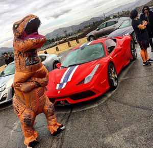 Dinosaur in front of a Ferrari 458 Speciale