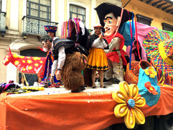 Parade float with guy and Hat