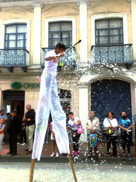 guy on stilts with fire and foam