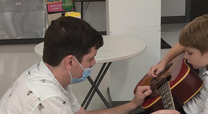 Preston on the guitar