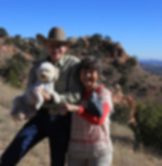 cowboy and artist with terrier and parrot on red cliffs