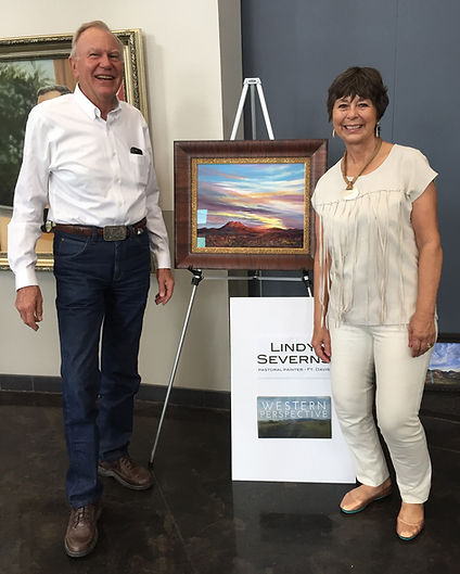 painting of desert sunset man in jeans artist lindy cook severns