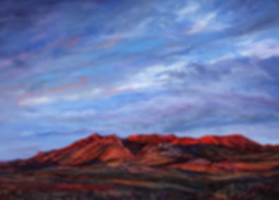Texas artist Lindy Severns paints sweeping sunrises over rugged red desert mountains such as this pastel landscape Riding the Red Dawn