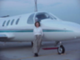 woman in long skirt and jet