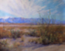 White clouds above blue desert mountains and cactus painting by Lindy Cook Severns