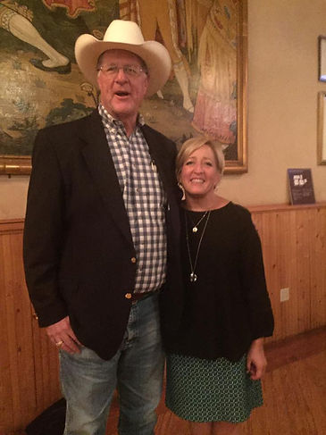 artist tim oliver in cowboy hat with lady missy oliver