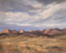 layered clouds float over peach and rust mountains and golden grass Marfa landscape painting Lindy Cook Severns art