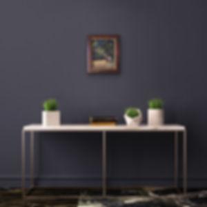 deer pastel painting framed on dark wall over table