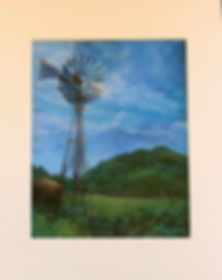 A rusty windmill spins above a green mt pasture in this Lindy Cook Severns matted remarque