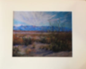 Clouds float above desert plants and mountains in this matted remarque by Texas artist Lindy C Severns
