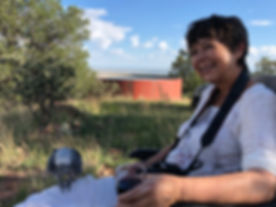 Artist Lindy Cook Severns and her African Grey companion high atop a Davis Mts ranch enjoying the view across West Texas
