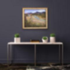 Rio Grande sandbar painting above table on dark wall
