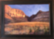 Sunrise on a golden desert canyon, a large oil landscape painting by Lindy Cook Severns framed in dark wood