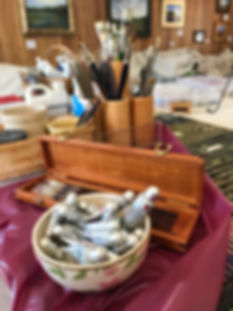 A china bowl of oil paints, a box of sable brushes in the studio of artist Lindy Cook Severns