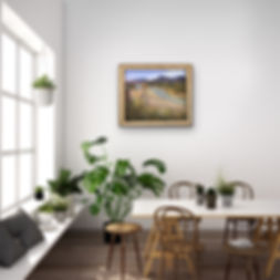 Framed landscape painting in breakfast room white wa