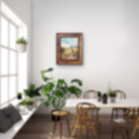 framed southwest art on white wall in dining room