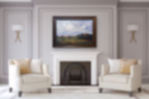 large summer landscape painting above white fireplace
