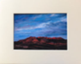 Red mountains beneath a blue dawn sky in this unique hand repainted print by Texas artist Lindy C Severns