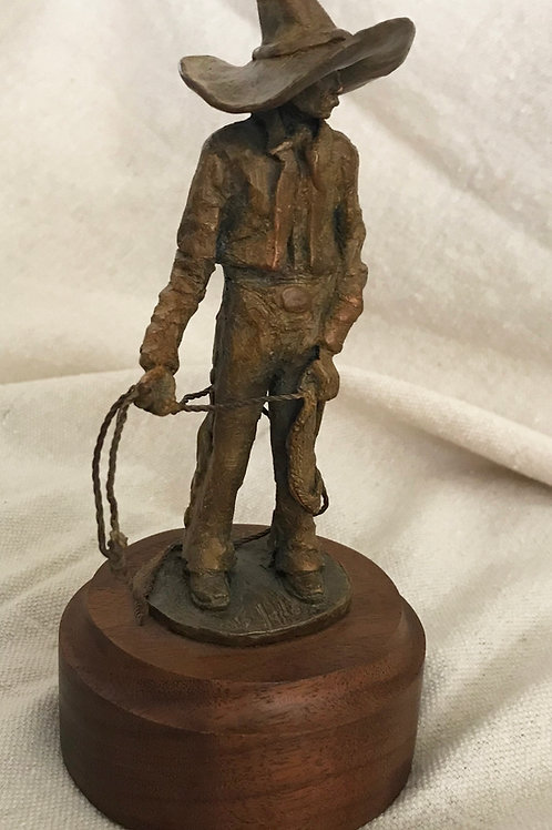 """small bronze cowboy in sombrero with rope, by Stephen G Jones """"Pedro"""""""