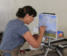 landscape painter lindy cook severns working at easel with pastels
