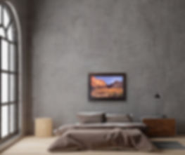 golden desert canyon oil painting on gray wall above bed