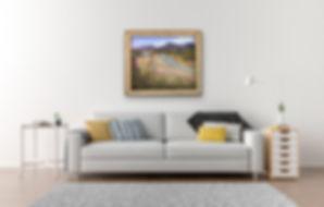 River sandbar painting on white wall over white sofa
