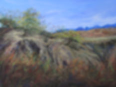 eroded draw with desert foliage against blue mts desert landscape pastel painting Lindy Cook Severns art