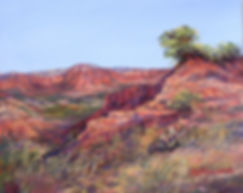 Red Texas canyons against a blue sky color this original painting by Lindy Cook Severns