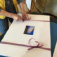 Ribbon wrapping on print.JPG