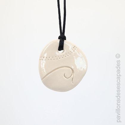 Engraved white earthenware pendant