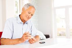 man measuring blood glucose.jpg