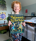 Noah holding the book copy.png
