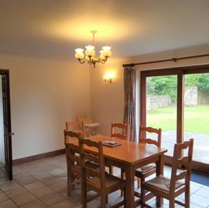 Dining room to kitchen Tyddyn Crwn Groun