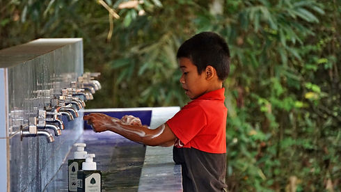 A child washes his hands