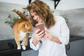 Empire Pet Care Happy Cat and Smiling Woman looking at phone