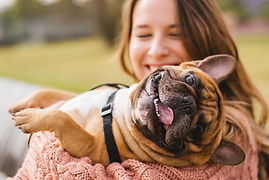 Empire Pet Care Woman holding smiling happy Dog