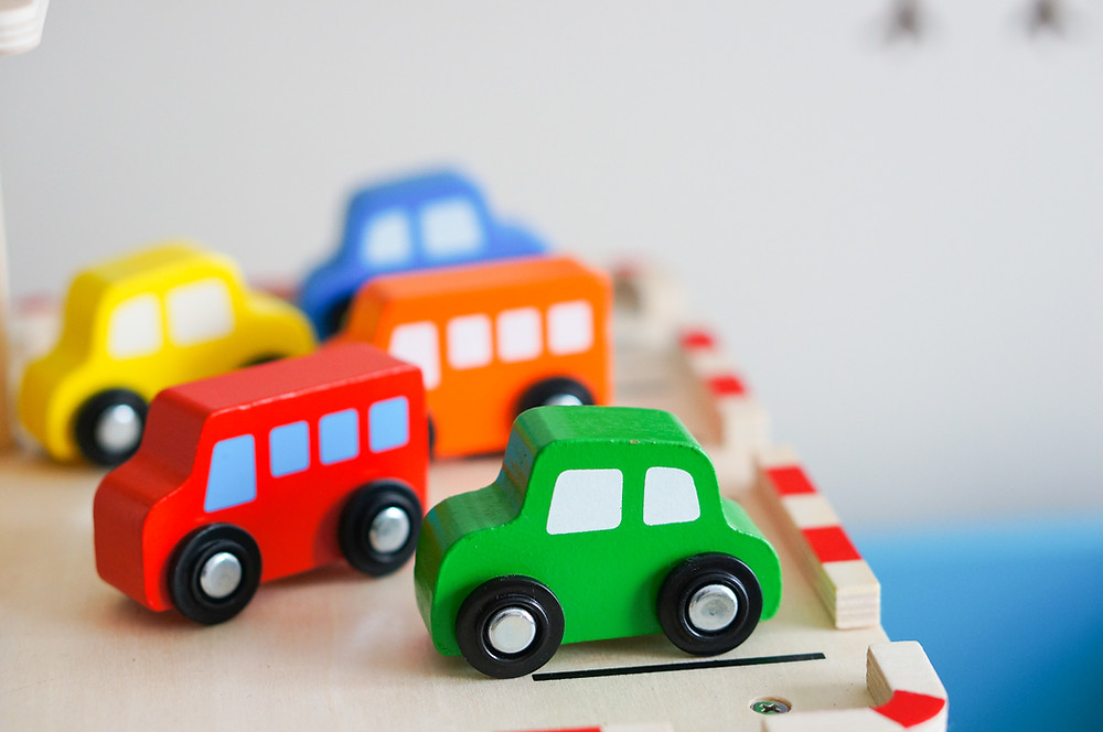 Image of 5 wooden brightly coloured painted vehicles