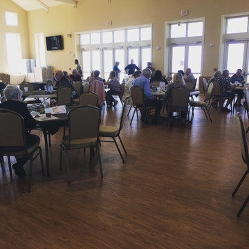 Citizens of the community dining together for Thanksgiving
