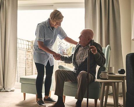nurse-supporting-senior-patient-at-home-