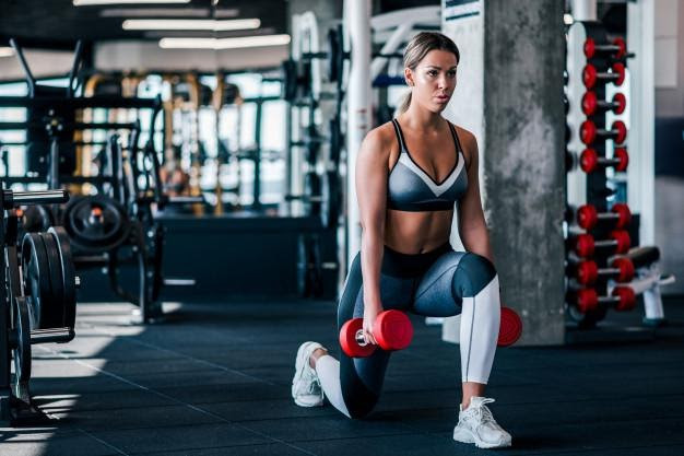 woman tempo training dumbbell workout