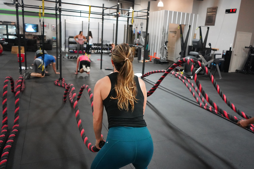 woman battle rope workout