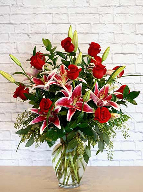 Fancy Red Roses with Star Gazers in vase with filler
