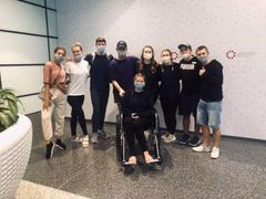 After many weeks, the cast secured travel plans to return home to the UK. Cast member in the wheelchair was injured when she slipped down stairs before their departure.