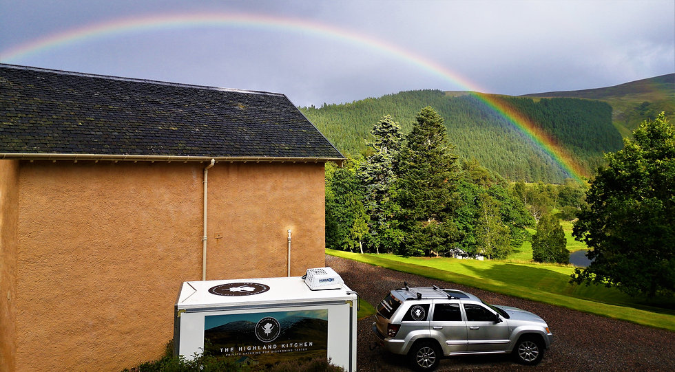 rainbow jeep and trailer.jpg