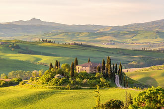 Farm house on a hill in Tuscany landscap