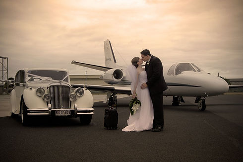 wedding beside plane.jpg