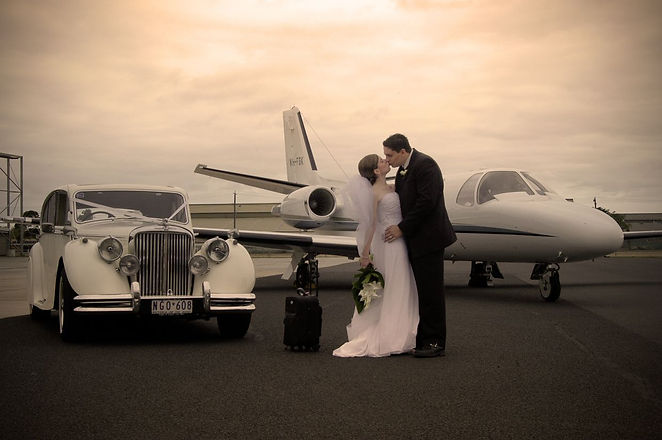wedding beside plane.jpg