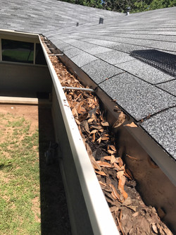 Screen Gutters Before by ametex roofing waco texas