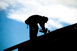man fixing the roof ametex roofing waco texas